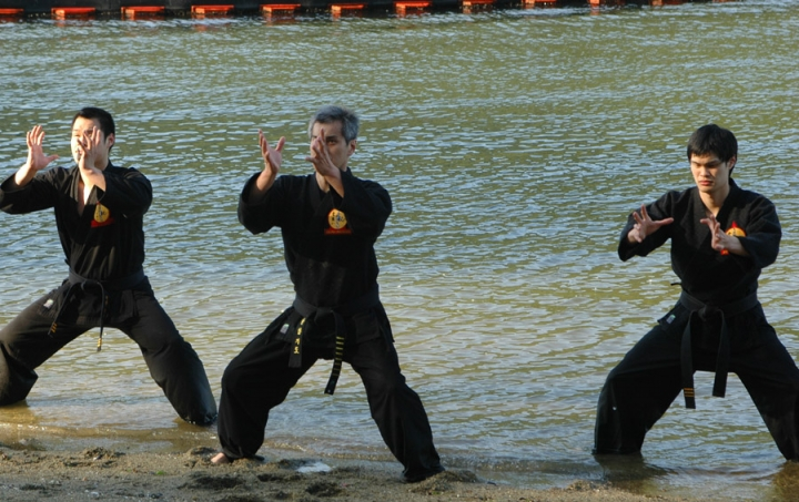 Master Thomas Lok, Billy & Chris performing the 'Chi' pattern in the Martial Arts Rhythm.